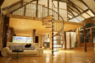 4556703-open-space-living-room-and-second-floor-mezzanine-in-cozy-house